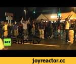 Ferguson erupts again: Tear gas, looting as protesters, cops clash,News,,Protesters and police clashed in Ferguson on Saturday as officers used tear gas and rubber bullets to deter the demonstrators. People were seen looting three stores on Florissant Avenue, including a hair and beauty shop. Some